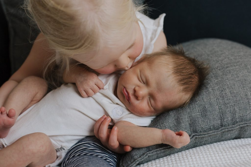 Auckland Photographer poses Newborn with sister